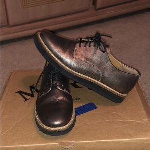 Clark's metallic loafers